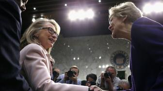 WASHINGTON, DC - JANUARY 24:  U.S. Secretary of State Hillary Clinton (L) greets Sen. Elizabeth Warren (D-MA) as they arrive for Sen. John Kerry's (D-MA) confirmation hearing before the Senate Foreign Relations Committee to become the next Secretary of State in the Hart Senate Office Building on Capitol Hill January 24, 2013 in Washington, DC. Nominated by President Barack Obama to succeed Hillary Clinton as Secretary of State, Kerry has served on this committee for 28 years and has been chairman for four of those years.  (Photo by Chip Somodevilla/Getty Images)