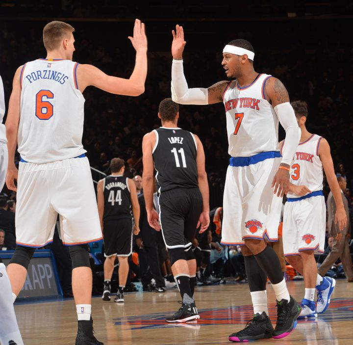 Porzingis, left, and Carmelo Anthony high-five each other in the Knicks' game against the Brooklyn Nets at Madison Square Gar