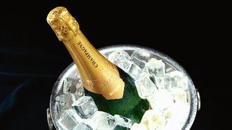 high angle view of a champagne bottle in an ice bucket