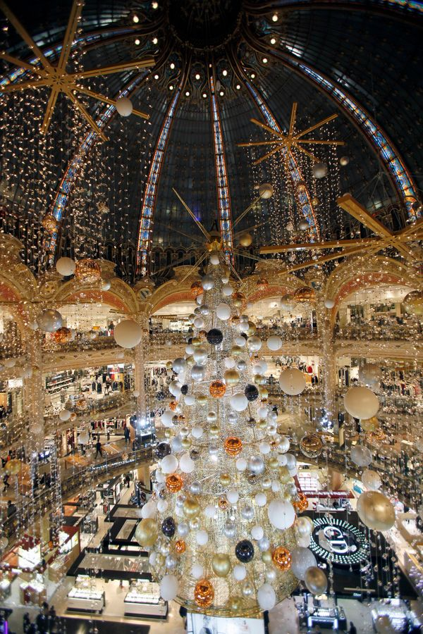 A giant Christmas tree stands in the middle of Galeries Lafayette department store.