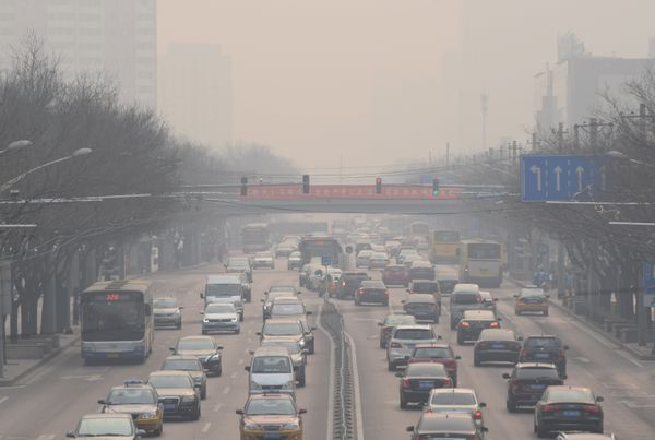 Vehicles drive through heavy smog.