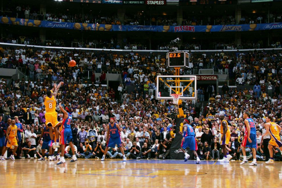 On June 8, 2004, Bryant hits a deep shot over Richard Hamilton withjust ticks remainingon the clock, tying up Gam