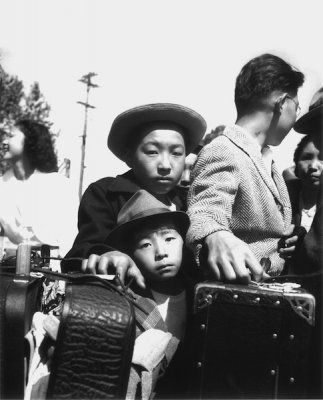 Young evacuees of Japanese ancestry wait their turn for baggage inspection, Turlock, CA, 1942