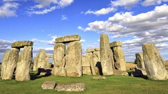 Stonehenge an ancient prehistoric stone monument near Salisbury, Wiltshire, UK. It was built anywhere from 3000 BC to 2000 BC. Stonehenge is a UNESCO World Heritage Site in England.