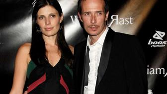 **FILE** Scott Weiland, right, and wife Mary, left, pose on the red carpet during a fashion show at a nightclub in Los Angeles, on Oct. 17, 2006. Hours after the couple brawled at a luxury hotel, she was arrested for torching the Velvet Revolver lead singer's clothes outside their Toluca Lake, Calif., home, police said Monday, March 26, 2007.(AP Photo/Dan Steinberg)