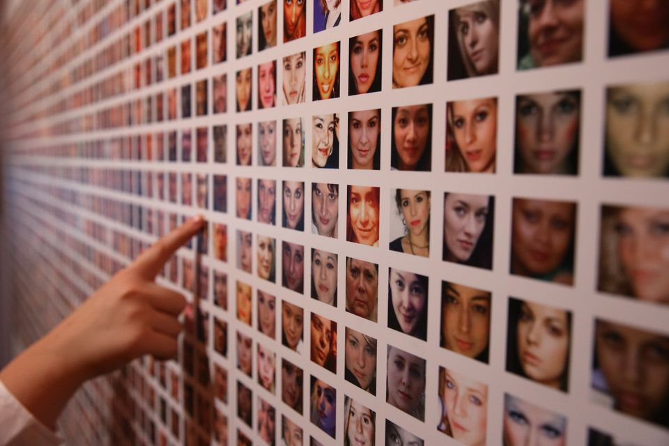 Some of the photographs of a million users of Facebook collated by artists Paolo Cirio and Alessandro Ludovico are displayed