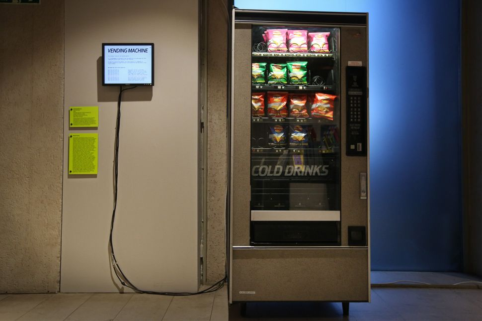 A vending machine dispenses crisps when the BBC RSS news feed uses key words at the Big Bang Data exhibition at Somerset Hous