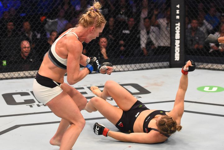 Holm follows up after knocking down Ronda Rousey during UFC 193.