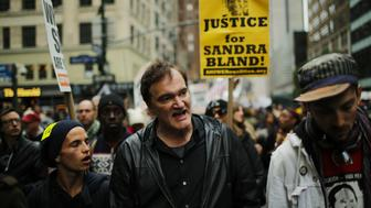 US film director Quentin Tarantino (C) takes part in a march against police brutality called 'Rise up October' on October 24, 2015, in New York. Campaigners demanding an end to police killings of unarmed suspects demonstrated and marched through Manhattan.  AFP PHOTO/EDUARDO MUNOZ ALVAREZ        (Photo credit should read EDUARDO MUNOZ ALVAREZ/AFP/Getty Images)