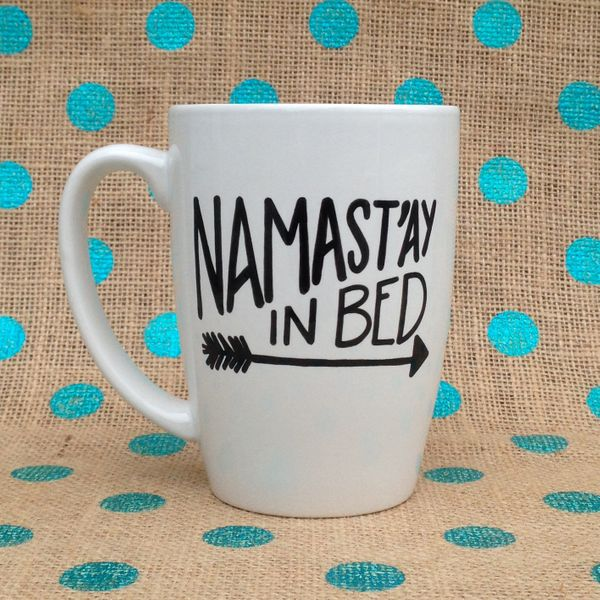 """<a href=""""https://www.etsy.com/listing/230246304/funny-coffee-mug-namastay-in-bed"""">Namast'ay In Bed Mug, $16</a>"""