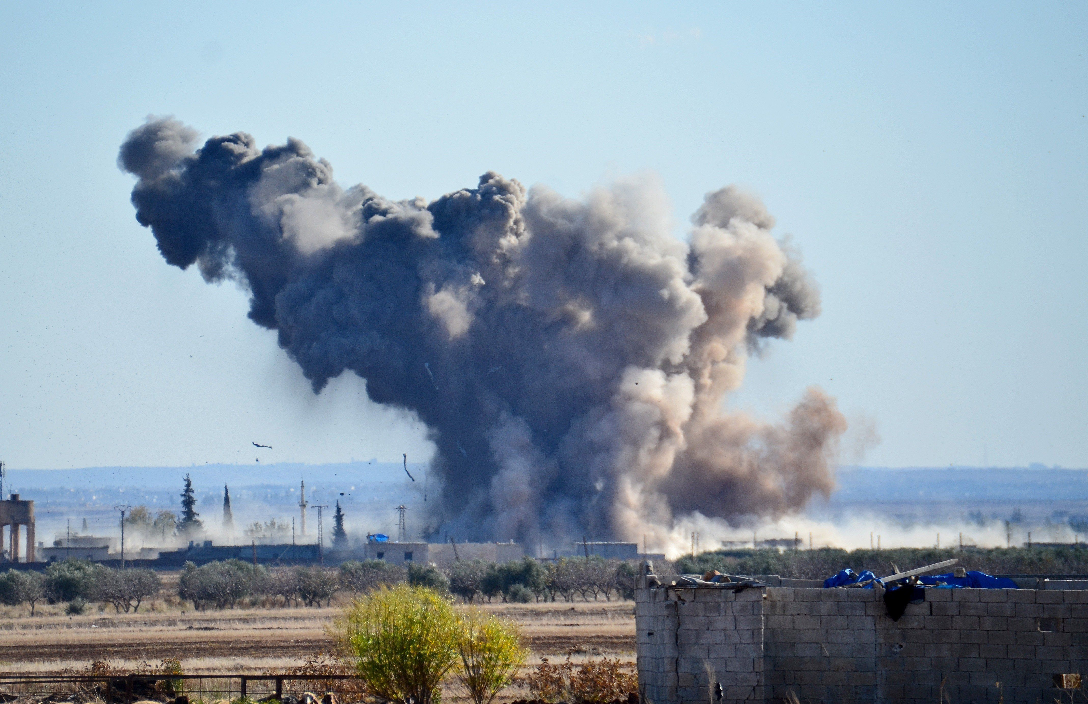 ALEPPO, SYRIA - DECEMBER 03: Smoke rises after the US-led coalition airstrikes' hits DAESH positions at Brekida village in Aleppo, Syria on December 03, 2015. (Photo by Huseyin Nasir/Anadolu Agency/Getty Images)