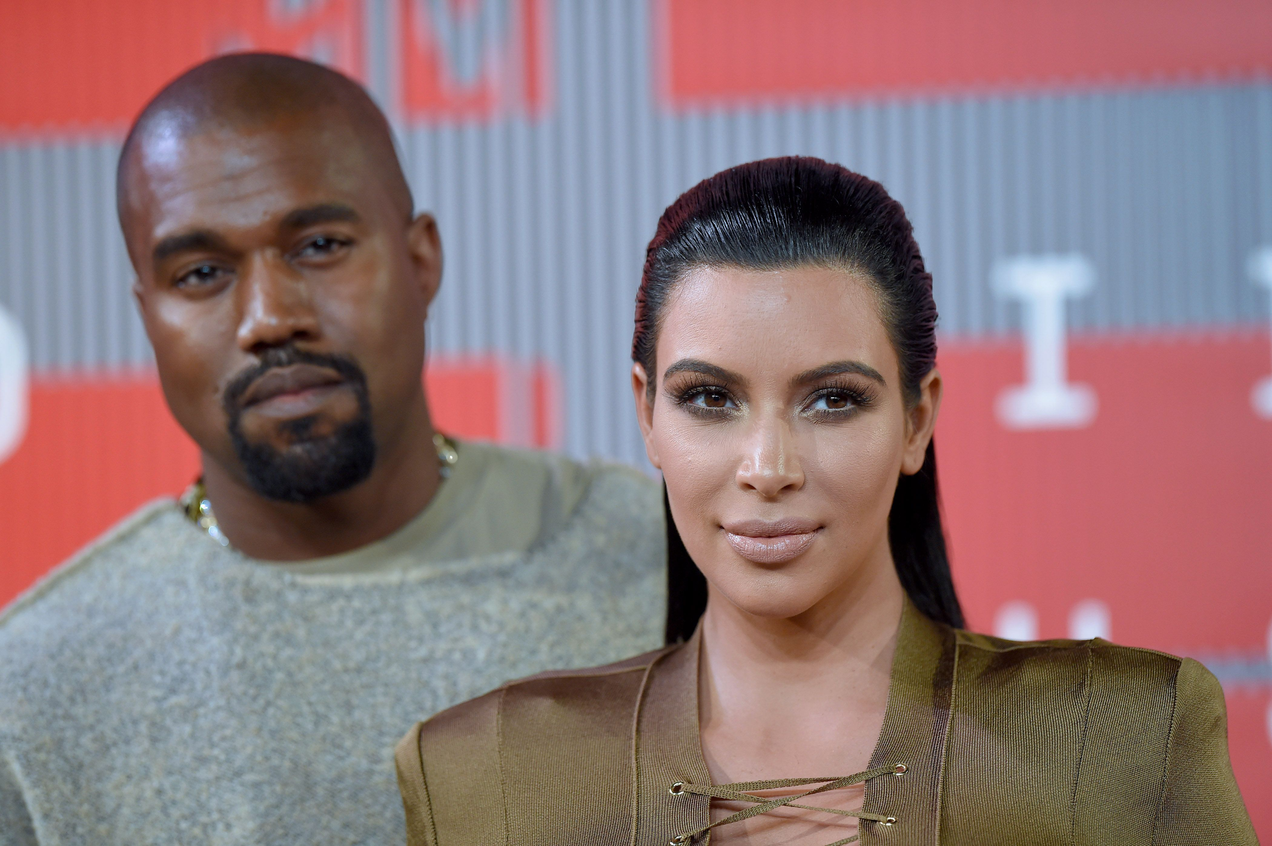 LOS ANGELES, CA - AUGUST 30:  TV personality Kim Kardashian and recording artist Kanye West arrive at the 2015 MTV Video Music Awards at Microsoft Theater on August 30, 2015 in Los Angeles, California.  (Photo by Axelle/Bauer-Griffin/FilmMagic)