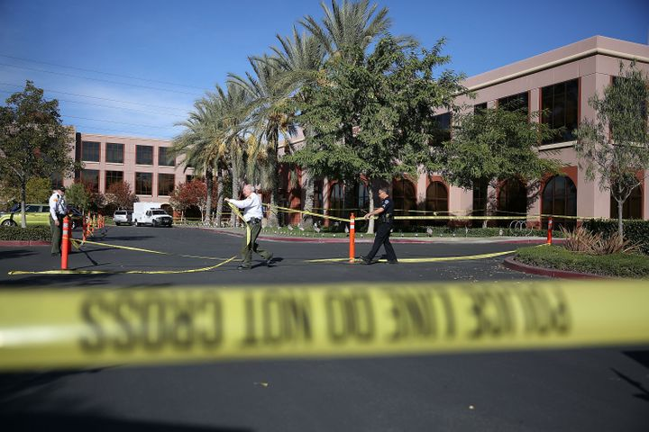 Officials put up police tape in front of the building at the Inland Regional Center were 14 people were killed on Dec. 2 in S