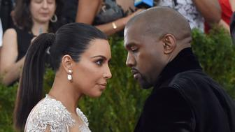 Kim Kardashian and Kanye West arrive at the 2015  Metropolitan Museum of Art's Costume Institute Gala benefit in honor of the museums latest exhibit China: Through the Looking Glass  May 4, 2015 in New York.      AFP PHOTO /  TIMOTHY  A. CLARY        (Photo credit should read TIMOTHY A. CLARY/AFP/Getty Images)