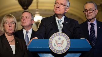 UNITED STATES - NOVEMBER 17 - From left, Sen. Patty Murray, D-Wash., Senate Minority Whip Richard Durbin, D-Ill., Senate Minority Leader Harry Reid, D-Nev., and Sen. Chuck Schumer, D-N.Y., listen to a question during a news conference after the weekly Senate Democrats luncheon in the U.S. Capitol in Washington, Tuesday, November 17, 2015. (Photo By Al Drago/CQ Roll Call)