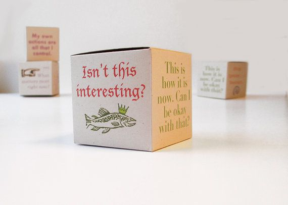 The idea is simple -- a 2-inch box that your loved one can put on a desk, with challenging statements and questions cove