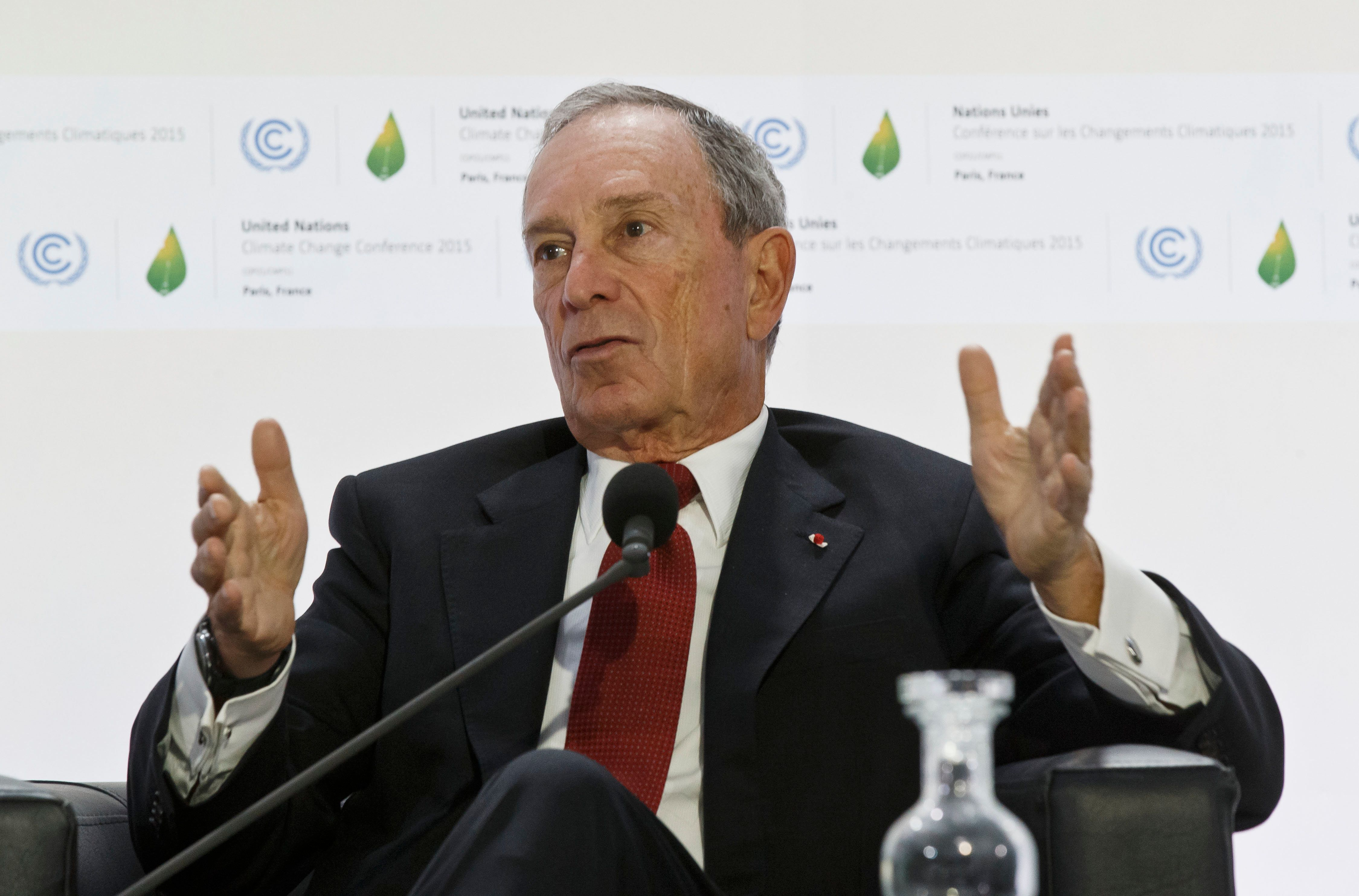 "Former New York City Mayor Michael Bloomberg, right, gestures as he speaks during a panel discussion on""Climate Change and Financial mMarkets""at the COP21, United Nations Climate Change Conference, in Le Bourget north of Paris, Friday, Dec. 4, 2015. (AP Photo. (AP PhotoMichel Euler)"