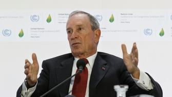 """Former New York City Mayor Michael Bloomberg, right, gestures as he speaks during a panel discussion on""""Climate Change and Financial mMarkets""""at the COP21, United Nations Climate Change Conference, in Le Bourget north of Paris, Friday, Dec. 4, 2015. (AP Photo. (AP PhotoMichel Euler)"""