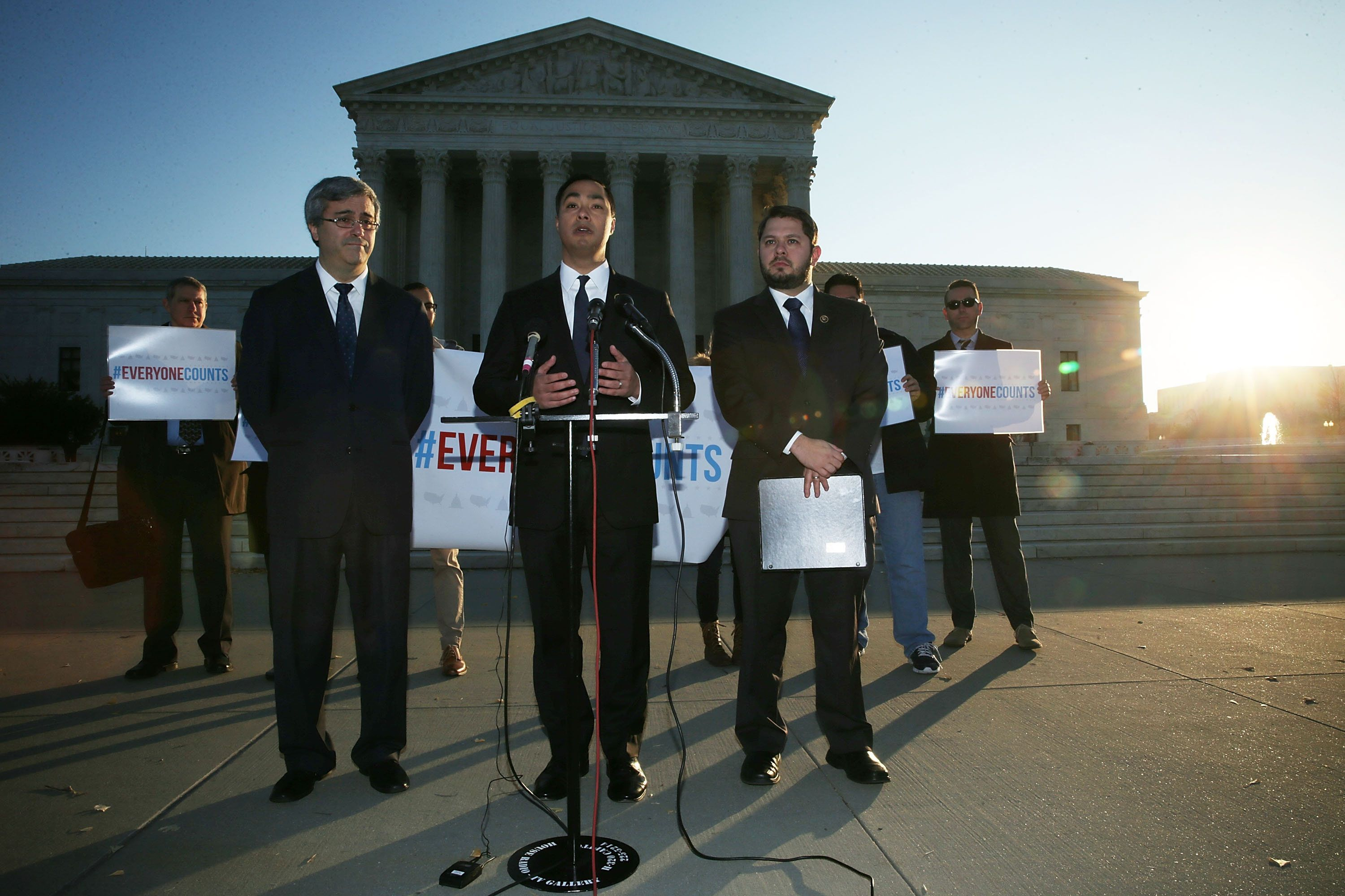WASHINGTON, DC - DECEMBER 08:  U.S. Rep. Joaquin Castro (D-TX) (C) speaks as Rep. Ruben Gallego (D-AZ) (R) and Mexican American Legal Defense and Education Fund President and General Counsel Thomas Saenz (L) listen during a news conference in front of the Supreme Court December 8, 2015 in Washington, DC. The Congressional Hispanic Caucus held the news conference on the day the Supreme Court hears oral arguments on Evenwel v. Abbott, 'on whether voting districts should continue to be drawn by using census population data, which include noncitizen immigrants, or whether the system should be changed to count only citizens eligible to vote, as conservative challengers are seeking.'  (Photo by Alex Wong/Getty Images)
