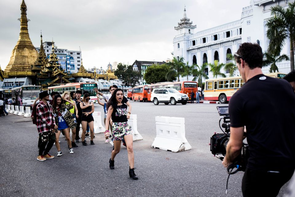 Ah Moon and her dancers film amusic video in front of the ancient stupa theSule Pagoda indowntown