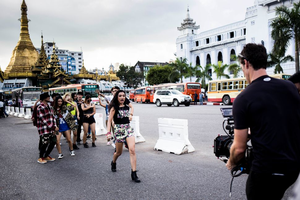 Ah Moon and her dancers film amusic video in front of the ancient stupa theSule Pagoda indowntown Yangon.