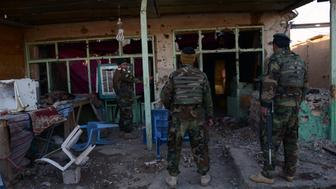 Afghan National Army soldiers inspect buildings after clashes against security forces at Kandahar Airport on December 9, 2015, a sprawling complex which also houses a joint NATO-Afghan base. At least 37 people were killed when Taliban insurgents wearing military uniforms stormed Kandahar airport, triggering pitched gun battles in a lengthy siege as President Ashraf Ghani on December 9 sought to revive peace talks at a regional conference.The raid on the sprawling complex, which also houses a joint NATO-Afghan base, is seen as the most serious attack on the largest military installation in southern Afghanistan in 14 years of war. AFP PHOTO / Jawed Tanveer / AFP / JAWED TANVEER        (Photo credit should read JAWED TANVEER/AFP/Getty Images)
