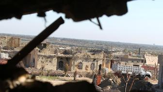 A picture taken on December 7, 2015 shows damaged buildings in the rural town of Husayba, in the Euphrates Valley seven kilometres (4.5 miles) east of Ramadi, where Iraqi government forces have been closing on Islamic State (IS) group militants who seized the Anbar province's capital in May after a three-day blitz involving dozens of huge truck bombs. Iraqi security forces have fought their way to the outskirts of Ramadi, where they have been battling the IS jihadists in the past weeks. AFP PHOTO / AHMAD AL-RUBAYE / AFP / AHMAD AL-RUBAYE        (Photo credit should read AHMAD AL-RUBAYE/AFP/Getty Images)