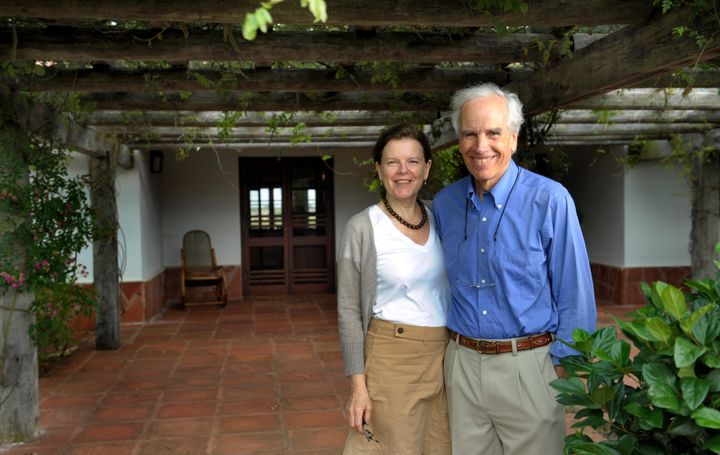 """U.S. billionaire Douglas Tompkins (R) and his wife Kristine pose in the front of their house at the estate """"Rincon del Socorr"""