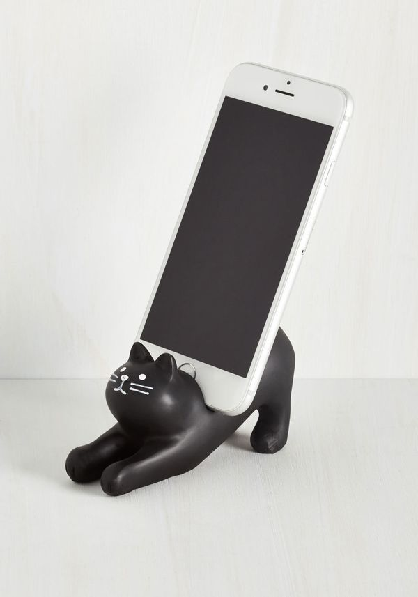 """You've Gato Call Phone Stand, $21.99,<a href=""""http://www.modcloth.com/shop/phones-accessories/you-ve-gato-a-call-phone-"""