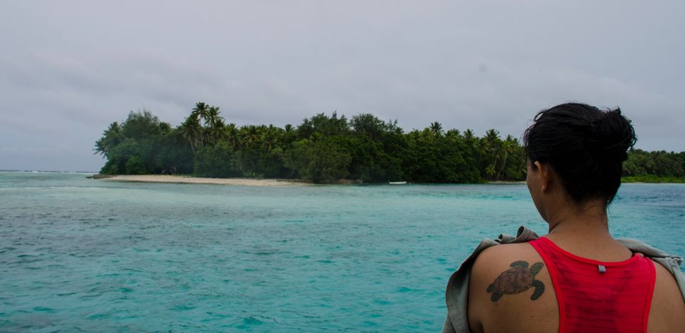 Candice Guavis looks out over the lagoon at one of the remote islands on Majuro Atoll.