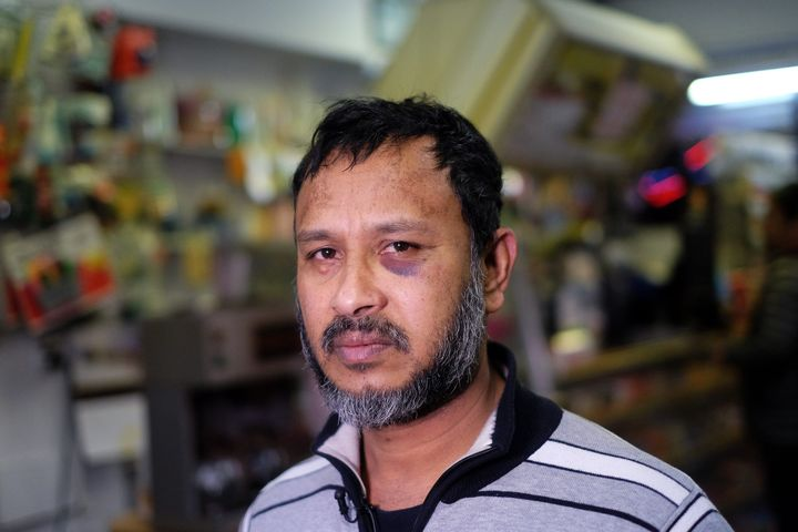 Muslim shopkeeper Sarkar Haq, who was beaten in an alleged hate crime, speaks during an interview at his shop in New York on