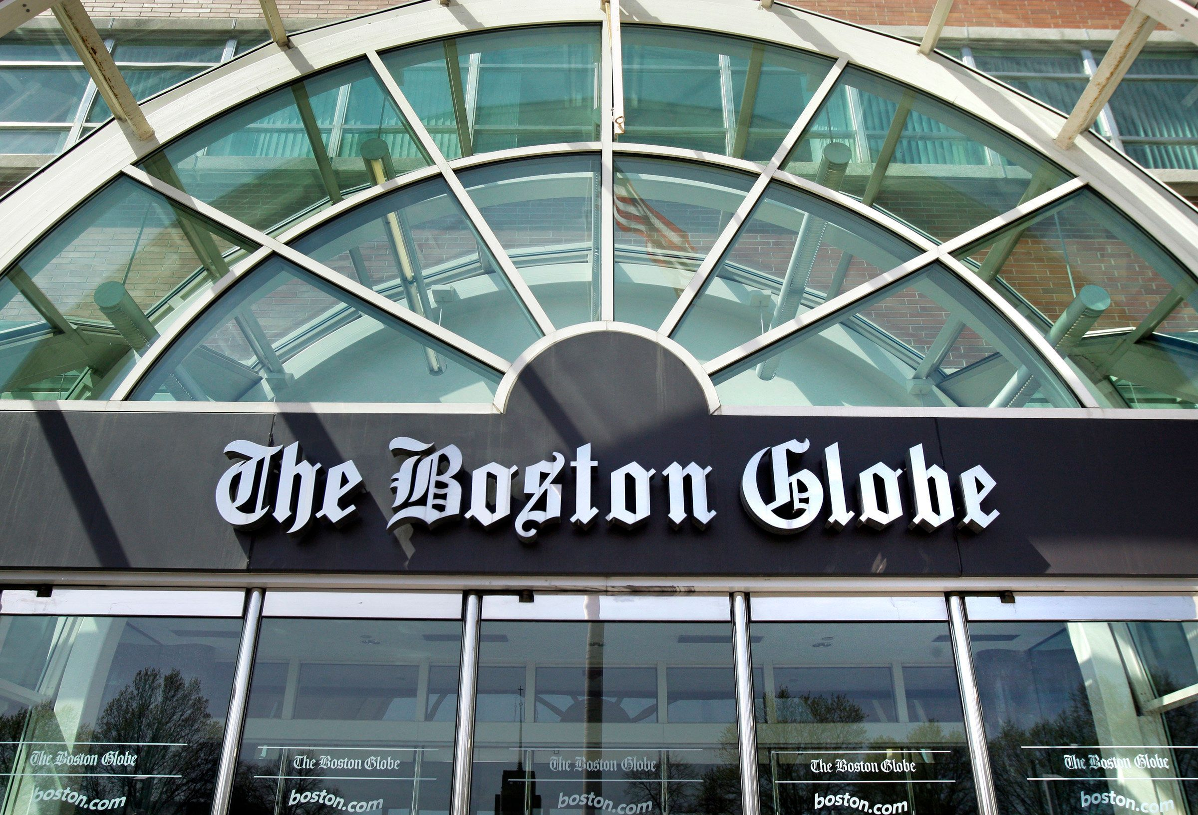 The facade of The Boston Globe building is seen in Boston Thursday, April 30, 2009. The publisher of The Boston Globe has warned employees to be ready to make sacrifices but said he's hopeful that the paper will survive a threatened closure by its owner, The New York Times Co. Publisher Steve Ainsley sent an e-mail to all employees Thursday, a day before the Times Co.-imposed deadline for the newspaper's unions to agree to $20 million in concessions or face a possible shutdown. (AP Photo/Elise Amendola)