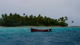 A small local fishing boat in the lagoon on Majuro Atoll.