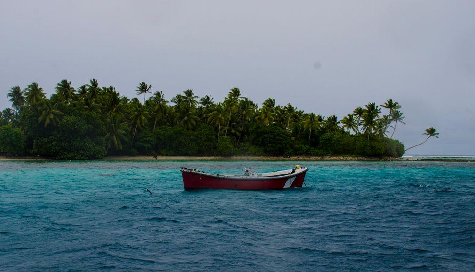 A small fishing boat in the lagoon on Majuro Atoll.