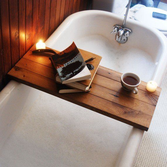 This bath caddy made of reclaimed wood can hold candles, a book, or tea for a long and luxurious bath.