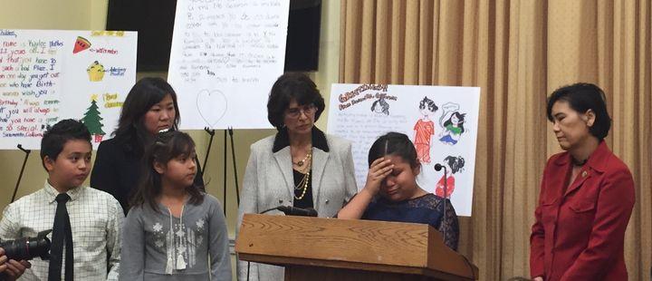 Nine-year-old Fiorella Zuniga, flanked by California Reps. Lucille Roybal-Allard (left) and Judy Chu (right), beganto c