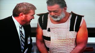 COLORADO SPRINGS, CO - NOVEMBER 30:  Colorado Springs shooting suspect, Robert Lewis Dear (R) appears before Judge Gilbert Martinez via video feed with public defender, Dan King, at the El Paso County Criminal Justice Center November 30, 2015 in Colorado Springs, Colorado. Dear is accused of attacking a Planned Parenthood clinic in Colorado Springs on November 27 and killing three people, including a police officer. Nine others were injured. (Photo by Daniel Owen-Pool/Getty Images)