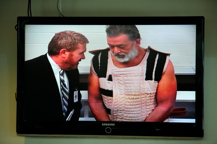 Robert Dear (right) appears with public defender Dan King (left) in his first court appearance in this photo from Nov. 30.&nb