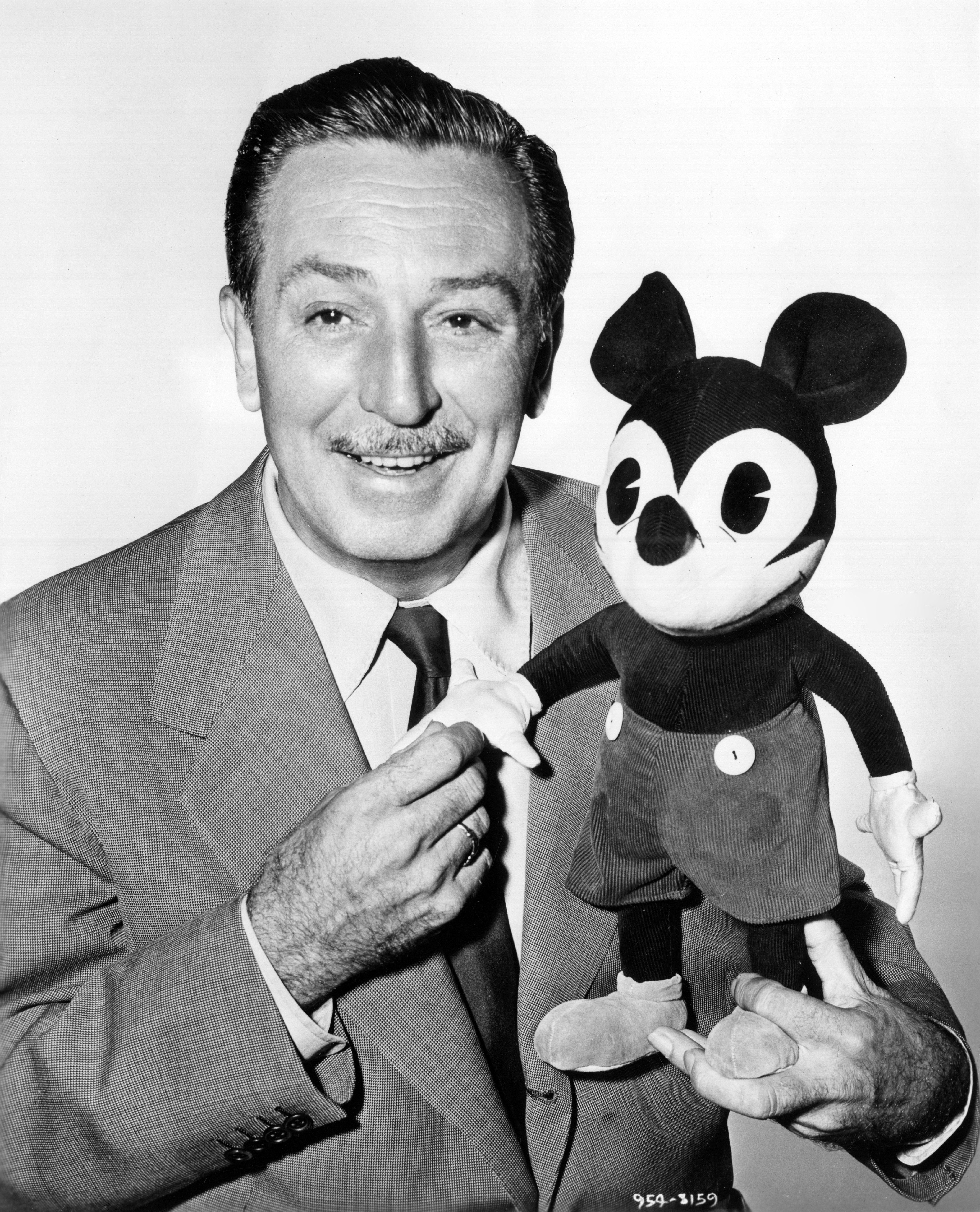 The American cartoonist and director Walt Disney with a plush puppet of Mickey Mouse. 1950s (Photo by Mondadori Portfolio via Getty Images)