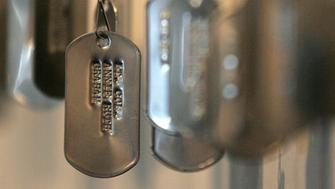 CHICAGO - APRIL 29:  Military-style dog tags are seen displayed in an art exhibit titled 'Women On War' at the National Vietnam Veterans Art Museum April 29, 2005 in Chicago, Illinois. 'Women On War' is an art piece dedicated to the 67 American women on died in the Vietnam War, eight of which were military personnel, the other 59 were civilians. The 30th anniversary of the fall of Saigon, and what is considered the end of the Vietnam war, will be marked on April 30.  (Photo by Tim Boyle/Getty Images)