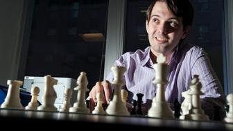 Martin Shkreli, chief investment officer of MSMB Capital Management, sits behind a chess board in New York, U.S., on Wednesday, Aug. 10, 2011. MSMB made an unsolicited $378 million takeover bid for Amag Pharmaceuticals Inc. and said it will fire the drugmaker's top management if successful. Photographer: Paul Taggart/Bloomberg via Getty Images ***Local Caption ** Martin Shkreli