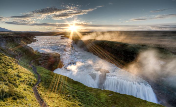 Mighty Hvítá river cascading at dawn over gullfoss waterfall in Southwest Iceland.