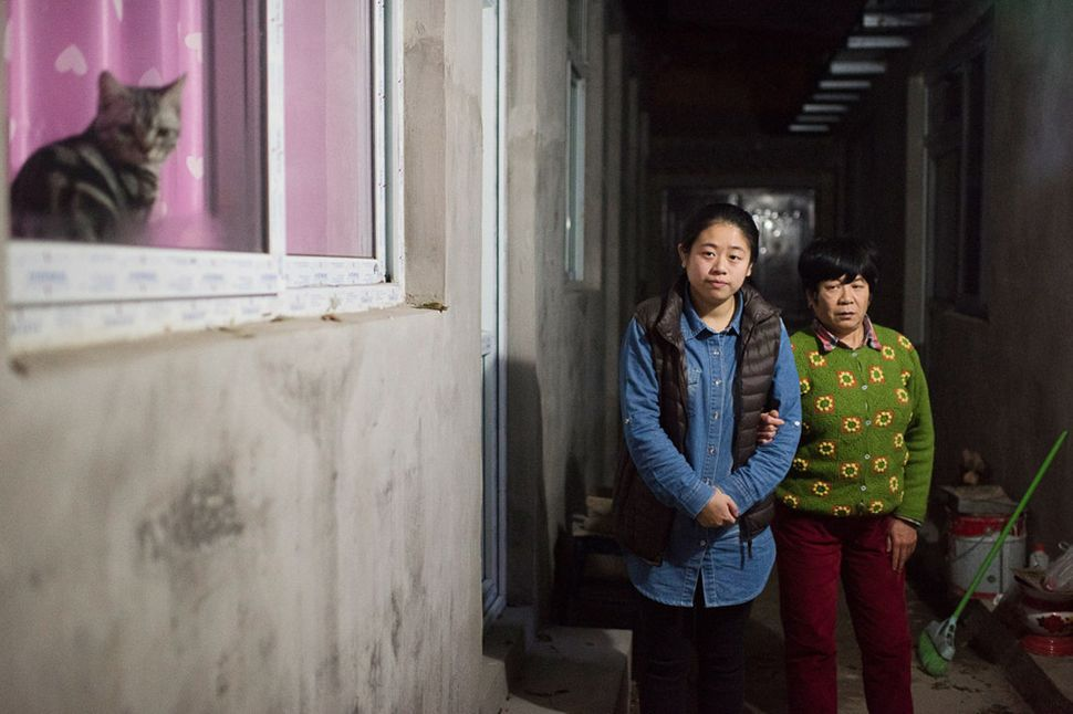 Li Xue and her mother outside their Beijing home.