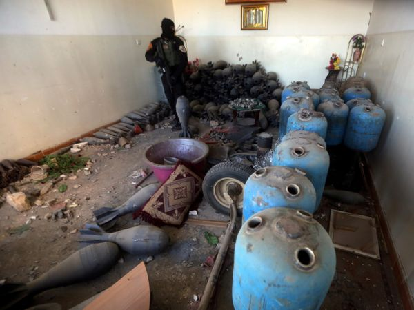 Iraqi counter-terrorism forces inspect an arms depot that belonged to Islamic State group fighters in Ramadi, Iraq.