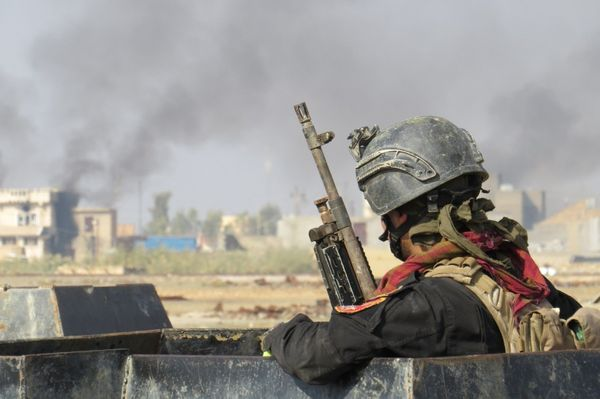 An Iraqi soldier patrols after clashes between Iraqi forces and Islamic State group fighters in Ramadi, Iraq, on Nov. 20, 201