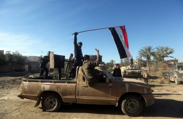 Iraqi counter-terrorism forces drive a truck that belonged to Islamic State group fighters in Ramadi, Iraq, on Dec. 9, 2015.