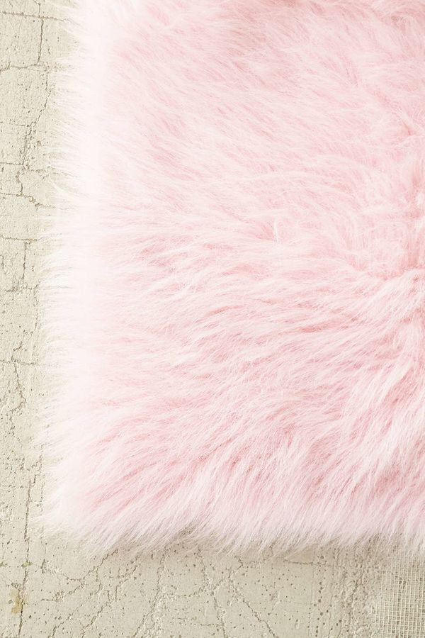 """Faux Sheep Skin Rug, $59 at <a href=""""http://www.urbanoutfitters.com/urban/catalog/productdetail.jsp?id=22867501&amp;category="""