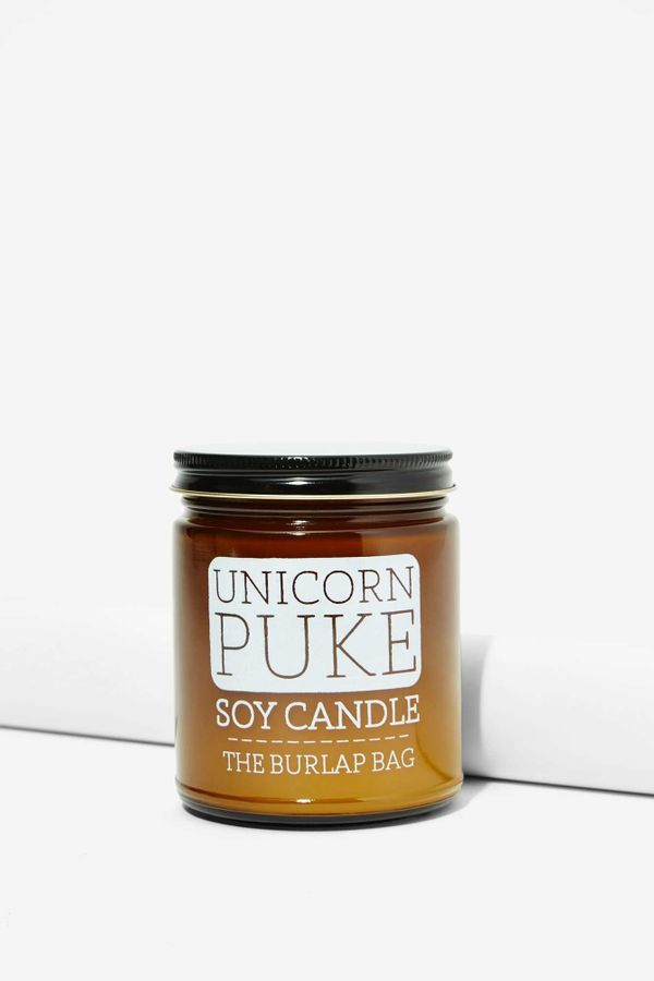 "Unicorn Soy Candle, $16 at <a href=""http://www.nastygal.com/all-gifts/the-burlap-bag-unicorn-puke-soy-candle"" target=""_blank"""
