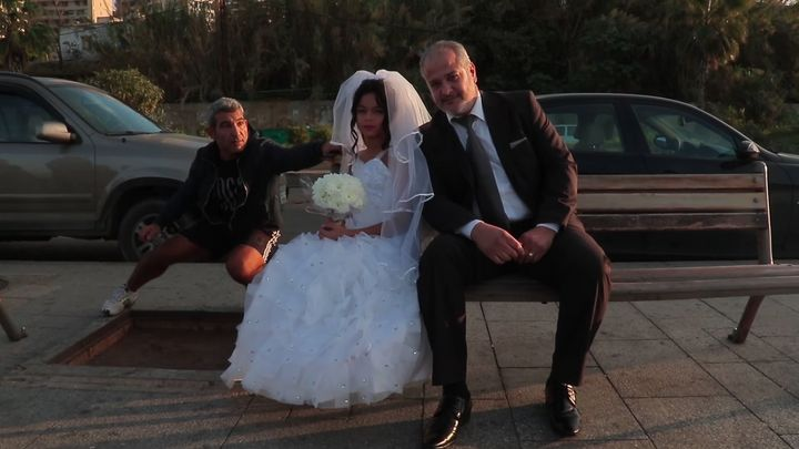 Lebanese women's rights organization Kafa made a video, featuring a stagedwedding photo shoot between a young girl and