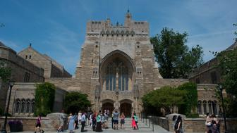 A tour group makes a stop at the Sterling Memorial Library on the Yale University campus in New Haven, Connecticut, U.S., on Friday, June 12, 2015. Yale University is an educational institute that offers undergraduate degree programs in art, law, engineering, medicine, and nursing as well as graduate level programs. Photographer: Craig Warga/Bloomberg via Getty Images